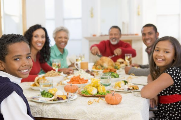 Family Gathered at Holiday Dinner Table