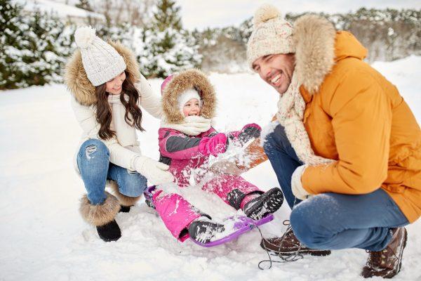 Family plays in snow near Albany NY